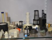 A display of filters with different sizes and shapes on a shelf.
