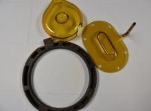 Two yellow parts and a black circular part that were molded with engineered resins.