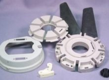 An image of several gears and parts on a table.