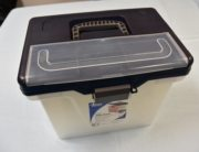 A plastic black and tan Office Depot file box.