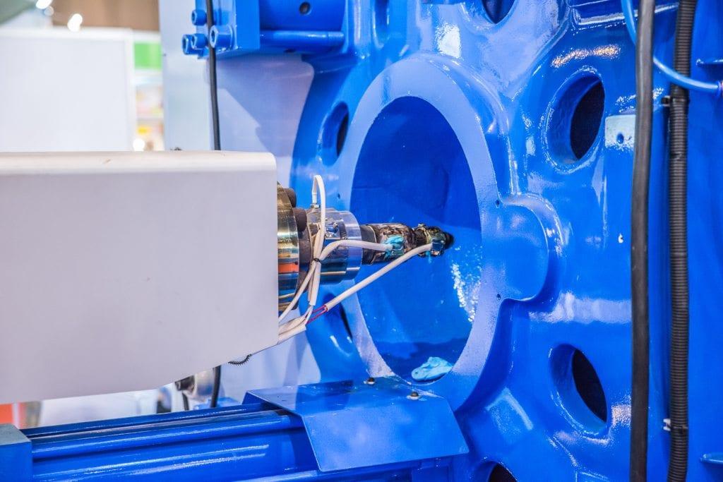 A bright blue machine in a manufacturing plant.
